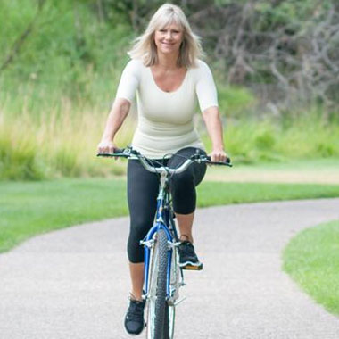 Woman biking with WearEase Compression Garment